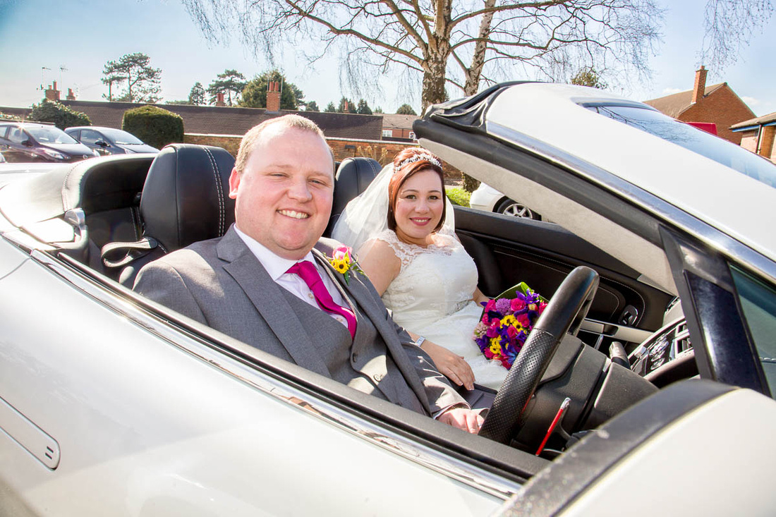 Leicestershire wedding photographer: James and Ruth at Oadby with the Aston Martin