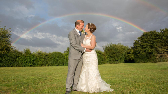 Catching the moment with a wedding rainbow