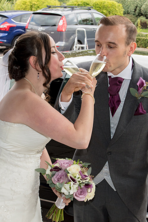 Bedford Wedding Photographer: Champagne on arrival at The Sharnbrook Hotel