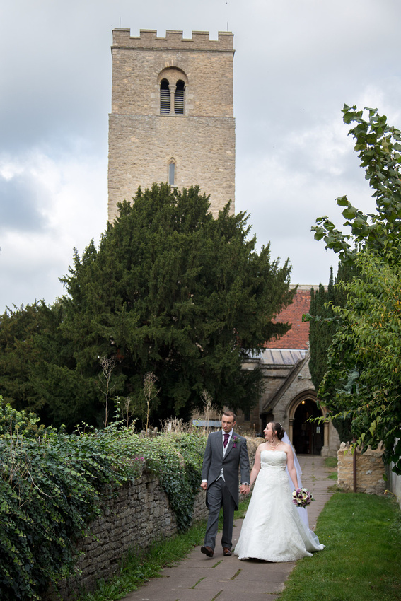 Bedford Wedding Photographer: Bride and groom going for a little walk