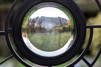Glass lens window to Clare College gardens