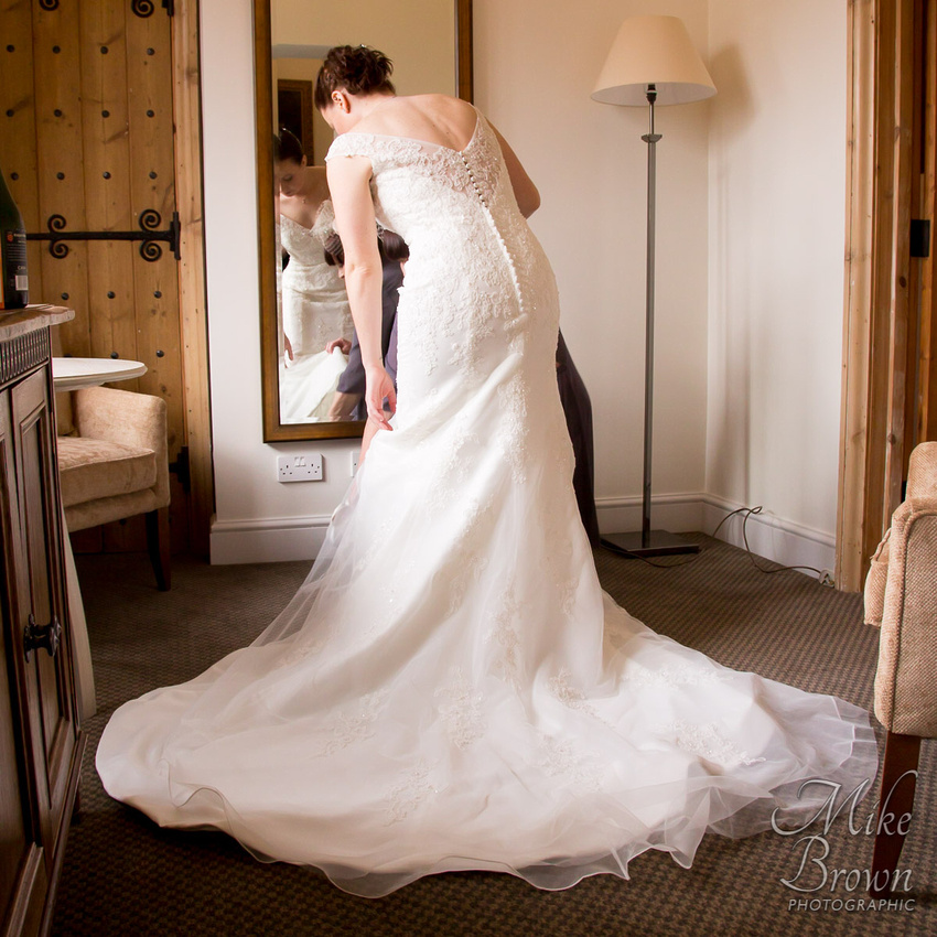 fawsley Hall wedding photographer: Wedding dress with plunging lace back