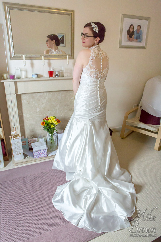 Leicester wedding photographer: Bare-shoulder wedding dress with heart-shaped detail